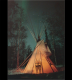 Canvas tipi against the Northern lights at night