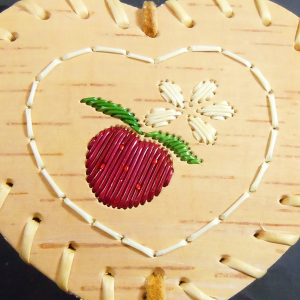 Small heart shaped birch bark basket with purple berry quill design