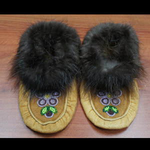 Hand made traditional kids sized moccasins with purple beaded design
