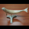 Side view of muskox horn beluga carving