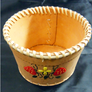 Round open birch basket with 2 strawberries and yellow flower