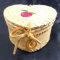 Side view of heart shaped birch basket with porcupine quill design
