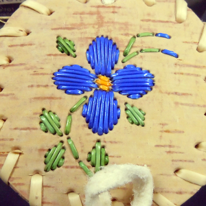 Small birchbark basket with 4 blue petal design