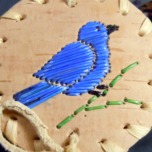 Small birch basket with blue bird made of quills